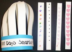 """100 Days Crown - We make this crown on the 100th day of school. To start, you staple 10-1 1/2""""  head. You then put a brass fastener through all of the holes and that makes the crown."""
