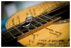 Unique guest book option. Everyone signs an old guitar with sentimental value. I could see me doing something like this