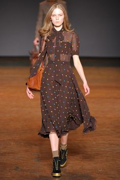Marc Jacobs Fall 2011. This is an ideal for me. It's a perfect look from the earth-toned calf length dress, shoes and handbag. I would wear this right now, so if anyone wants to give me the perfect gift, this dress would do just fine. :)
