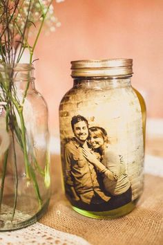 Put Black & White or Sepia Tone Pictures inside pretty Jars...so unusual but a nice touch for the Guests at Your Wedding Reception ~ You may even find that some went a missing at the end of the evening ~ (Neat for the Kitchen too, change the Pics with the Seasons ♥)