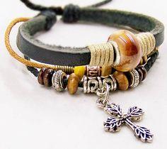 handmade bracelets leather cuff  wristband cotton Rope wooden Beads Metal Cross Adjustable bracelets. $6.99, via Etsy.