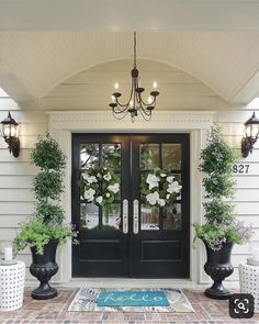 Farmhouse front door ideas that will give your home a whole new look. Discover front door ideas that are sure to give your visitors a stylish welcome. Double Front Entry Doors, Front Door Porch, Front Door Entrance, House Front Door, House With Porch, Front Door Decor, Front Door Planters, Double Door Wreaths, Black Front Doors