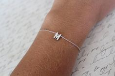 Tiny Silver Initial Bracelet...Small Initial Bracelet...bridal party jewelry gift idea birthday by brinandbell on Etsy https://www.etsy.com/listing/162620578/tiny-silver-initial-braceletsmall