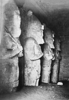 Interior of temple of Abu Simbel, Egypt | Royal Collection Trust | Antonio Beato (c. 1825-c. 1903) (photographer) | Taken in 1882 | Photograph showing row of four statues wearing the crown of Upper Egypt, inside one of the Temples of Abu Simbel, Nubia, Egypt, partially excavated.