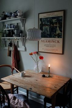 Rustic wood table, cafe chairs, hanging lamp