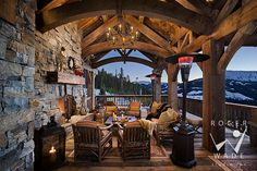 Amazing outdoor patio area of this Montana log and timber frame home