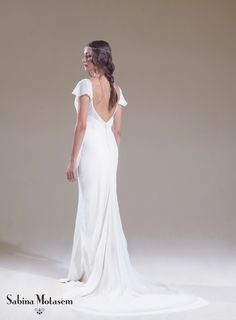 The Lily dress  – Sabina Motasem. A bias cut, backless, silk georgette overlay over a slinky satin Elsa wedding dress with little floaty sleeves and a puddle train, Can be accessorised with a matching satin sash. www.motasem.co.uk #biascutweddingdress #backlessweddingdress #sabinamotasem