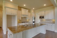 White kitchen cabinets, tan countertop