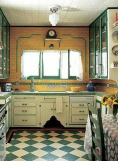 Art deco kitchen... yellow tiled walls with white and green tiles counter tops... with a green checked flooring...wow this reminds me of my long time ago rental ..love it