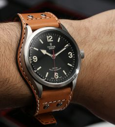 Tudor Heritage Ranger Watch. Swiss made. Self winding. I love the strap that contours with and underneath the watch case.