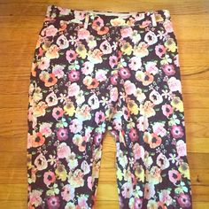 NWOT floral pants Super cute/comfy floral print ankle pants. Multicolored pink, yellow, and orange flowers. Black background H&M Pants