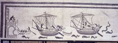 Mosaic with cargo ships arriving in port; the ship's boat transports people and goods, while a lighthouse maintenance worker tends to the light, all above a sea populated by dolphins and fish - from the domus at Diotallevi Palazzo, Rimini, Italy