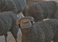 Jean Luc Cornec's new exhibit at the Museum of Communications in Frankfurt presses visitors to recall more simplified times through a flock free-roaming sheep sculpted from old, analog, rotary phones.