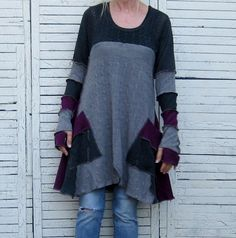This item is reserved for Maria, please do not purchase unless you are her.    Nice flowing form in this up-cycled sweater tunic in grays and dark