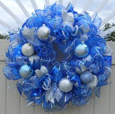 This wreath was finished with some blue and silver deco flex tubing loops. Description from etsy.com. I searched for this on bing.com/images