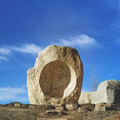 Listening Stones, St. Vrain Greenway, Longmont, Colorado. Granite river boulders, wood, flagstone. 1997. This sculpture uses a parabolic sound mirror carved into boulders to dramatically magnify the sound of a nearby stream for listeners. The concept of sound reflection has been known for centuries, such as at the Whispering Wall in China.