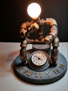 Check out this item in my Etsy shop https://www.etsy.com/listing/493397761/pipe-lamp-the-thinker-robot-clock