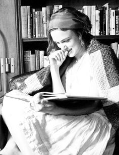 """Knightly reads. """"I can't get rid of books. It's almost like having your thoughts [around you]. I want to be hable to hold it. I want to be able to see where the pages were turned down. I grew up in house full of books. Wall to wall."""" - Keira Knightly"""