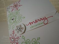 """Close up of Endless Wishes in Gumball Green, Real Red Ink stamped directly on notecard.  Little banner cut and stamped with greeting. Small snowflake stamped in Soft Suede ink  & punched with a 3/4"""" Circle Punch & popped using a Stampin' Dimensional. Rhinestones added for embellishment."""