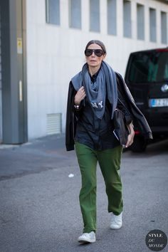 Green trousers, white sneakers