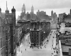 New York City, Lower East Side, the future site of Knickerbocker Village, 1933.The now defunct Hamilton St. (called the Lung Block) is on the left, Monroe St. is on the right. The skyscrapers in the background are (left to right), the Cities Services Building (most recently the AIG building and 70 Pine St.), the Bank of Manhattan Trust Building (40 Wall St., now a Trump Building), and the Singer building, located at the corner of Broadway and Liberty St., which was demolished in 1968.