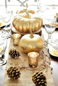 Fall Thanksgiving Tablescape. Love the idea of using branches, pinecones, and metalic frosted votives to line the center of a holiday table!