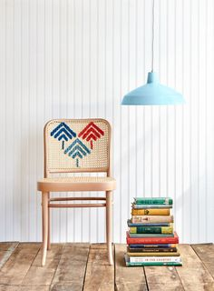 Give the ubiquitous thrift store find a makeover with a colorful, stitched design. Step 1: Use a pattern to trace a design onto the chair in pencil. Step 2: Use a back stitch to thread chunky yarn (available at craft stores) through each opening. TIP: To maneuver yarn more easily, wrap the ends with tape.   - CountryLiving.com