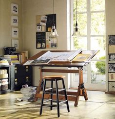 I always wanted to be an architect. For my projects, I still make line art drawings. I take notes on graph paper during business meetings. And I want a drafting table (like this one, which I believe is from Pottery Barn) in my office in our next house (which will have space for *my* office).
