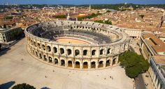 The Arena of Nîmes is situated in the French city of Nîmes. The building external facade is 21 metre-high decorated with 120 arches divided over two levels. Inside is an elliptical area 133 meters long by 101 meters wide, and surrounded by 34 rows of seats supported by a vaulted construction. In the old times it had a capacity of 24,000 spectators but today holds just over 16,000.