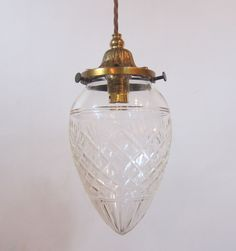Pair of English pendant lights in the original brass finish complemented by period cut glass shades. c 1900  www.antiquelightingcompany.com