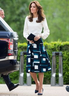 High street chic: Today Kate stepped out for a charity initiative at London's Queen Elizabeth Olympic Park wearing a £105 geometric print skirt by Banana Republic