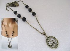 Long Necklace *+Snake+*.  Bronze colored chain with onyx gemstones, pendant an oval with snake surrounded by meander pattern.