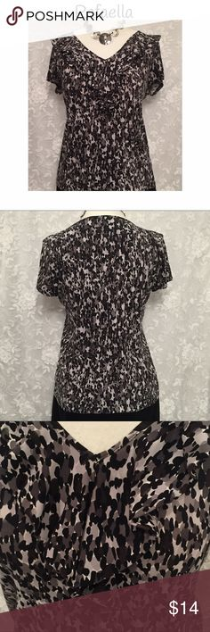 "RAFAELLA ruffle neckline blouse! Rafaella ruffle neckline blouse! In black, gray, and white! Super fun and cute with a pair of black pants or skirt. Loose fitting, stretchy fabric. Polyester and spandex. Measurements: chest-42, waist-40"", length-26"". Excellent used condition! (Necklace not included.) Rafaella Tops Blouses"
