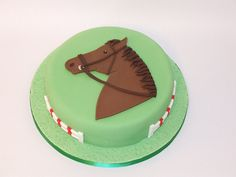 Chocolate cake with chocolate butter icing, iced with fondant. The horse's head and jumps are all made from hand cut fondant. Matilda Cake, First Communion Cakes, Paris Cakes, Horse Cake, Butter Icing, Harry Potter Cake, Book Cakes, Horse Birthday, Chocolate Butter