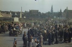 THE LIBERATION OF EINDHOVEN, HOLLAND, 20 SEPTEMBER 1944. Dutch civilians jump on the bonnet of a jeep in Eindhoven, as crowds cheer the British Army as it passes through.