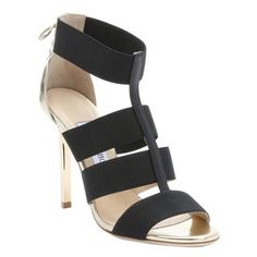 Jimmy Choo Black and gold elastic strappy 'Dario' lace-up detail... ($684) ❤ liked on Polyvore