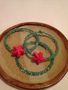 A personal favorite from my Etsy shop https://www.etsy.com/listing/230526602/acqua-red-starfish-beaded-bracelet