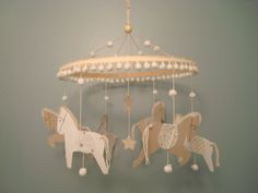 All the Pretty Little Horses - Carousel paper baby crib mobile - neutral, tan, brown, white, silver gold. $37.50, via Etsy.