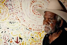 "Dickie Minyintiri, began to paint on canvas when he was 91. Five years later, in 2011, he won Australia's most prestigious prize for Indigenous art, the Telstra award.  His painting, Kanyalaukutjina (Euro tracks), is the story of more than 90 years walking his ""country."" It shows the tracks of kangaroos, dogs and emu coming to a water hole to drink … each layer and line is a memory of a journey he has undertaken. Dickie is also a senior Law Man and traditional healer."