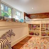 How cute! A  loft  bed, nestled above a bookshelf and toy storage area make for a seriously chic bedroom for the  kids .  | HGTV FrontDoor