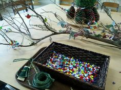 Group project - attaching wire, beads and other items onto a beautiful branch.