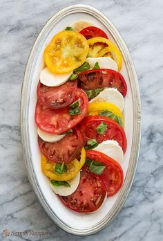 Heirloom Tomato Basil Mozzarella Salad  ~  Summer is tomato and basil season, and there is nothing better than heirloom tomatoes with fresh basil from the garden and fresh mozzarella cheese.