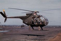 Vietnam Helicopter Pictures | Joe at the stick of his helicopter, with his door gunner behind him