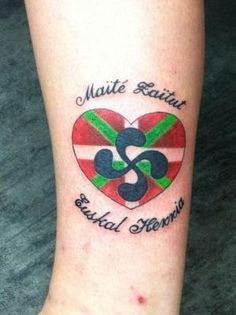 Another really cool looking tribal basque lauburu for Basque cross tattoos