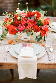 Brides.com: . To complement the vibrant color palette at their wedding, this couple scattered orange kumquats over their rustic wooden tables.