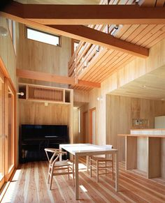 japan + denmark | use of wood and traditional japanese elements with danish hans wegner light wood chairs