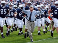 Penn State football coach Joe Paterno leads his team onto the field before a game against Akron, in State College, Pa., Sept. 4, 2004.