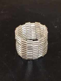 Silver tubular beads with a peyote stitch make this simple ring.  I am new at peyote and beading...I am a potter at heart.  I have always tried to add other textural elements to my clay pieces.  Learning the peyote beading stitch has been an inspiration for texture on clay.