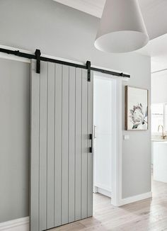 Unlike a standard hinged door that requires floor space to swing open, a sliding barn door takes up little more space than the thickness of the door. door ideas 17 design ideas for small hallways Sliding Barn Door Hardware, Diy Barn Door, Bathroom Barn Door, Sliding Door Design, Sliding Bedroom Doors, Closet Doors, Sliding Door For Bathroom, Indoor Sliding Doors, Indoor Barn Doors