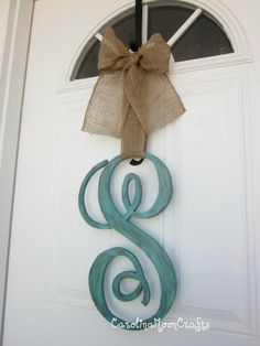 Big wood letter, paint and a ribbon! Great way to dress up a front door